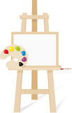 Wooden easel with a empty canvas. Palette and brush Stock Image