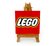 Wooden easel paper with word Lego. Tambov, Russian Federation - September 27, 2015 Wooden easel paper with word Lego on it. White background. Studio shot stock photo