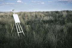 Easel on the field stock photo