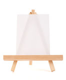 Wooden easel with white canvas Stock Photography