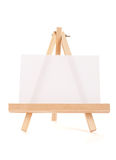Wooden easel with white canvas Stock Photo