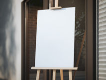 Wooden easel with a white canvas on the street Stock Photos