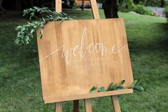 Wooden Easel With A Board. On The Board Written White Paint - Welcome Royalty Free Stock Images