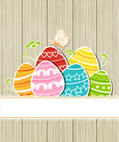 Wooden Easter background with eggs Royalty Free Stock Image