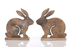 Wooden easter bunnies on white Royalty Free Stock Photos