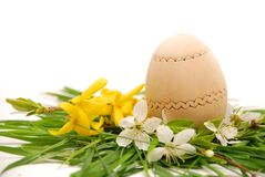 Wooden easter egg in a colorful spring nest Stock Image