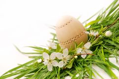 Wooden easter egg in a green grass nest Stock Photo