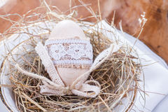 Wooden easter egg with lace. Wood egg easter decoration with lace Royalty Free Stock Photo