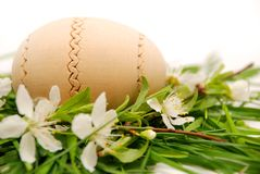Wooden easter egg in a spring nest Stock Photo