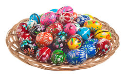 Wooden Easter Eggs arrangement. Colorful hand painted Easter Eggs in a wicker bowl Royalty Free Stock Photography