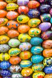 Wooden easter eggs background. Many painted handmade wooden easter eggs, eastern background Stock Images