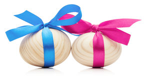 Wooden Easter eggs with bows  on white background Stock Image