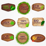 Wooden Eco labels , bages, stickers collection with green leaves and grass - Bio and natural product, natural, gluten Royalty Free Stock Photo