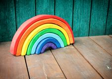 Wooden eco toy - rainbow puzzle. Royalty Free Stock Photography