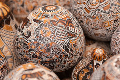 Wooden egg carvings. Intricate detail on hand crafted wooden eggs on market in Peru. South America Royalty Free Stock Image