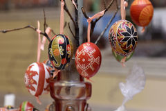 Wooden eggs decorated with ornaments handmade. Wooden eggs decorated with various ornaments handmade at the fair royalty free stock photography