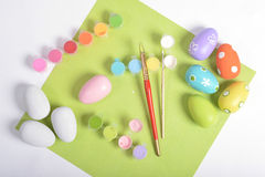 Wooden eggs and painting accessories Royalty Free Stock Images