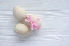 Wooden eggs with pink tape Royalty Free Stock Images