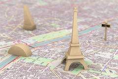 Wooden Eiffel Tower on the map of Paris. Extreme closeup Royalty Free Stock Photos