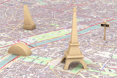Wooden Eiffel Tower on the map of Paris. Extreme closeup Stock Image