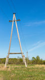 Wooden electric pillar against blue sky Royalty Free Stock Image