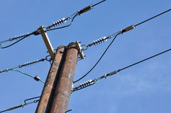 Wooden electric pole Stock Images