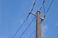 Wooden electric pole with power line Royalty Free Stock Photography