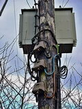 Wooden Electricity Pole. With high voltage cables and Junction Boxes royalty free stock images