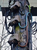 Wooden Electricity Pole. With high voltage cables and Junction Boxes stock photos