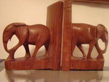 Wooden elephant bookends Stock Photos