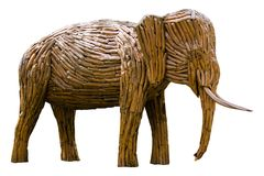 Wooden elephant made from tree`s root isolaed on white with clip Stock Photos