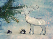 Wooden elk or reindeer ola rustic style christmas greeting card. Vintage winter holidays decoration on white background Stock Photography
