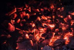 Wooden embers glowing pieces in stove Royalty Free Stock Photography