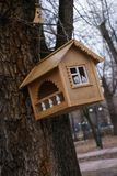 Wooden empty birdhouse hang on a tree. Wooden birdhouse hang on a tree Stock Image