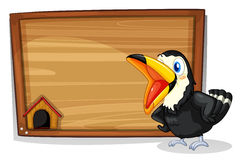 A wooden empty board with a black bird Stock Images