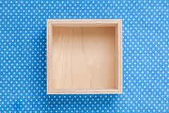 Wooden empty box on textile. Background. Top view Royalty Free Stock Photo