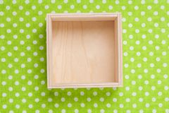 Wooden empty box on textile. Background. Top view Royalty Free Stock Photos