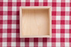 Wooden empty box on textile. Background. Top view Royalty Free Stock Photography
