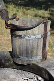 Wooden empty bucket at the well Royalty Free Stock Photos