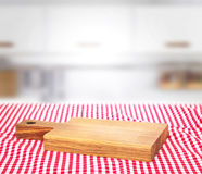 Wooden empty cutting board on picnic cloth background. Cutting wooden board over picnic tablecloth empty space food advertisement design Royalty Free Stock Image