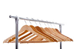 Wooden empty hangers for clothes on rack on white background. no Royalty Free Stock Images