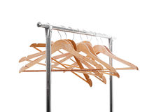 Wooden empty hangers for clothes on rack on white background. no Royalty Free Stock Photography