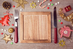 Wooden empty plate with rustic Christmas decorations. Menu background Stock Photos