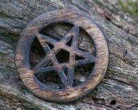 Wooden encircled pentagram symbol on fibrous tree bark. Five elements: Earth, Water, Air, Fire, Spirit. Wooden encircled pentagram symbol on fibrous tree bark stock photos