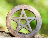 Wooden encircled pentagram symbol on fibrous tree bark. Five elements: Earth, Water, Air, Fire, Spirit. Wooden encircled pentagram symbol on fibrous tree bark royalty free stock photography
