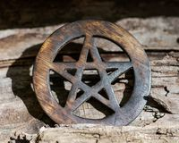 Wooden encircled pentagram symbol on fibrous tree bark. Five elements: Earth, Water, Air, Fire, Spirit. Wooden encircled pentagram symbol on fibrous tree bark stock photography