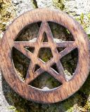 Wooden encircled pentagram symbol on fibrous tree bark. Five elements: Earth, Water, Air, Fire, Spirit. Wooden encircled pentagram symbol on fibrous tree bark royalty free stock photo