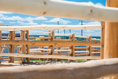 Wooden enclosures for animals on farm. And blue cloudy sky Stock Photos
