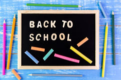 Wooden english alphabet Back to school on the blackboard. Stock Image