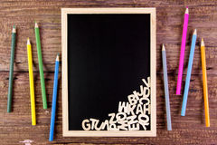 Wooden english alphabet on the blackboard.Color pencil on wooden. Table Royalty Free Stock Photography